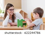 mother or preschool teacher... | Shutterstock . vector #622244786