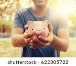 saving money concept.man hold... | Shutterstock . vector #622305722