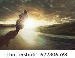 motorcycle rides through a...   Shutterstock . vector #622306598