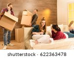 men holding cardboard box and... | Shutterstock . vector #622363478