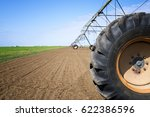 Small photo of Agriculture. Irrigation system on the field. Agronomy. Watering crops.