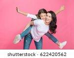happy mother piggybacking... | Shutterstock . vector #622420562