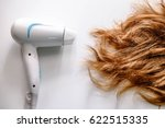 hair dryer and damaged hair | Shutterstock . vector #622515335