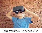 child using black 3d virtual... | Shutterstock . vector #622535222