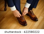 man tying shoes laces on the... | Shutterstock . vector #622580222