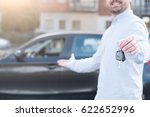 one man holding a car key next... | Shutterstock . vector #622652996