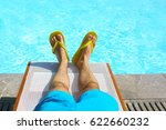 young man lying on sunbed near... | Shutterstock . vector #622660232