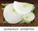 Slices Of White Onion In Woode...