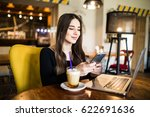 young woman sitting in coffee... | Shutterstock . vector #622691636