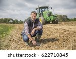 Farmer Examine Quality Of Soil...