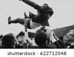 men tossing up groom at stylish ... | Shutterstock . vector #622712048