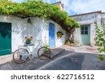 a alley in the city of ars en re | Shutterstock . vector #622716512
