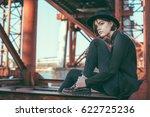 young girl in black dress.... | Shutterstock . vector #622725236