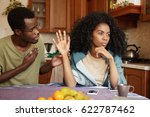 regretful unhappy young african ... | Shutterstock . vector #622787462
