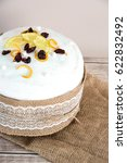Small photo of Easter composition of sweet bread, paska on wooden background. Orthodox kulich. Holidays breakfast concept