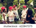 group of student is on a field... | Shutterstock . vector #622847375
