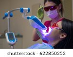 female patient at dentist in... | Shutterstock . vector #622850252
