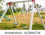 children swing at playground | Shutterstock . vector #622866716