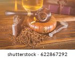 smoking pipe and notebook on... | Shutterstock . vector #622867292