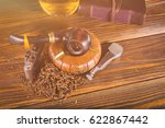 smoking pipe and notebook on... | Shutterstock . vector #622867442