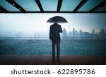 businessman hold umbrella stand ... | Shutterstock . vector #622895786
