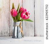 pink tulips in a rustic metal... | Shutterstock . vector #622905752