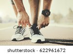 tying sports shoe. a young... | Shutterstock . vector #622961672