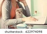 Stock photo young beautiful woman with cute cat using laptop at home 622974098
