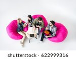 Students Sitting On Beanbag...