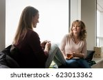 mother talking to her daughter... | Shutterstock . vector #623013362