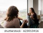 teen daughter with mother... | Shutterstock . vector #623013416