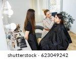 teacher training her student... | Shutterstock . vector #623049242