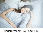 close up of sleeping woman in... | Shutterstock . vector #623051342