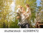 cheerful father playing with... | Shutterstock . vector #623089472