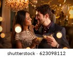 couple make toast at camera as... | Shutterstock . vector #623098112