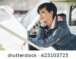 young pilot woman leaning on an ... | Shutterstock . vector #623103725