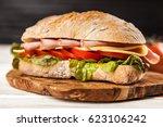delicious ciabatta sandwich | Shutterstock . vector #623106242