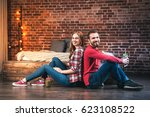 young couple at home   Shutterstock . vector #623108522