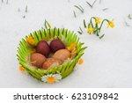 green basket full of easter... | Shutterstock . vector #623109842