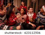 friends in festive jumpers... | Shutterstock . vector #623112506