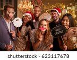 Stock photo group of friends dressing up for christmas party together 623117678