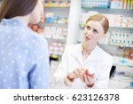 pharmacist talking to female... | Shutterstock . vector #623126378