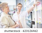 pharmacist with client... | Shutterstock . vector #623126462