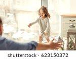 photo in motion. a little girl... | Shutterstock . vector #623150372