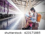 travel by train asian girl with ... | Shutterstock . vector #623171885