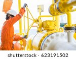 production operator opening big ... | Shutterstock . vector #623191502