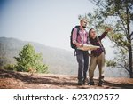 man and woman traveler with... | Shutterstock . vector #623202572