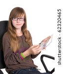 teenager in glasses with cosmetics bag - stock photo