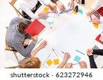 team sitting behind desk ...   Shutterstock . vector #623272946