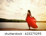 the beautiful girl with long... | Shutterstock . vector #623275295